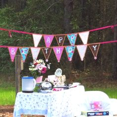 This is the birthday banner I made for Madeline's outdoor tea party. I used two kinds of ribbon, a hot glue gun, and fabric pieces. I chose to use adhesive felt to form the letters so that they can be interchanged if needed. I plan on using this for my two other daughters' birthdays and making one for my son's first birthday!