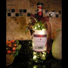 I love this wine bottle lamp on a kitchen counter! It would be super  easy to make with some LED lights and cute ribbon.