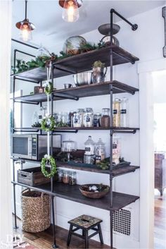 Industrial pipe shelving adds a modern feel to your kitchen space. Would you want this in your home?