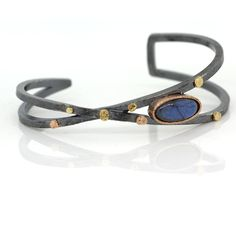 Criss-Cross Cuff Bracelet with Oval Labradorite by Rona Fisher. Criss-Cross Cuff Bracelet in oxidized sterling silver, 18k rose, and yellow gold with oval labradorite.
