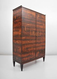 Tomaso Buzzi and Gio Ponti Attributed; Rosewood and Walnut Cabinet, c1930.