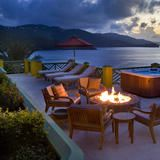 Take a dip in the hot tub, then cozy up by the fire pit for a view of the magnificent  waterfront  sunset.