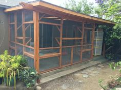 Custom enclosed porch catio, stained to match the existing structure