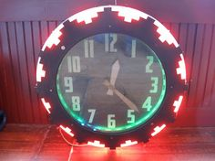 Schoolhouseantiques › Unique Odds and Ends  Aztec Neon Clock 1934 Vintage by Electric Clock Company Cleveland, 26 inch diameter