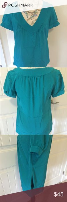 Rory Beca Silk Top  This stunning teal v-neck top is 100%silk. Pockets are shown in picture.  Rory Beca Tops