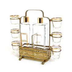 Vintage Bar Set Cocktails Mad Men Style !!! Drink up with this vintage drinking set. Scotch and Rye decanters with six matching shot glasses, this barware set dating from the 1950s A  terrific addition to any home. With gold accents and an ornate carrier, you'll want to have this at your next cocktail party to serve guests with retro style. Notes on condition: This is an actual vintage set and is in good condition. No chips or cracks.  dotandbo.com  #cocktails #mad_men #vintage #style