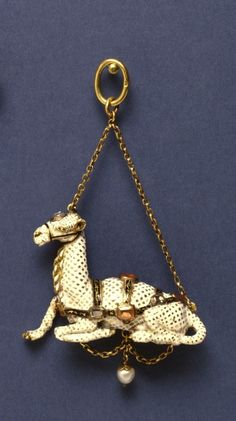 Pendant with a Camel, ca. 1600, gold, enamel, rubies, rock crystal; 1 7/16 x 1 15/16 in. (3.7 x 5 cm). The Art Walters Museum.