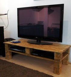 Pallet tv stand...I think I'd like it better painted tho #Pallettvstands
