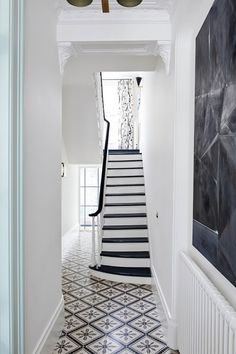 Step inside an art-filled Brooklyn townhouse. This gem will make art lovers swoon—step inside Hall Tiles, Tiled Hallway, Hallway Flooring, Hallway Furniture, Modern Furniture, Entry Tile, White Staircase, Black Stairs, Interior Staircase