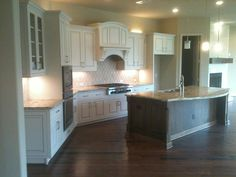 Light color kitchen cabinets with hardwood flooring... Love the openness of this!