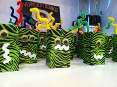 Halloween monster juice boxes! Duct tape, self adhesive google eyes, rickrack mouth, and pipe cleaner antennae!