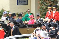 Cheers: The arrival of the royal party was met by cheers from the racegoers assembled at t...