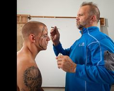 Road Warrior Animal painting the face of his son James Laurinaitis. James may play in the NFL, but wrestling is in his blood.
