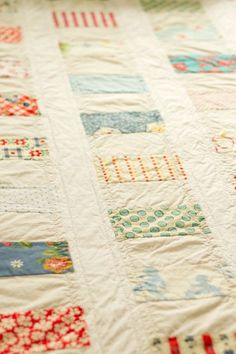 Simple strip-pieced quilt with in-lin sashing.  Love the quilting on this simple quilt