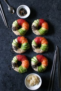 sushi doughnuts with salmon tuna avocado and cucumber @thedelicious