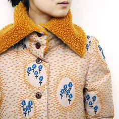goldenrod yellow, forget-me-not blue, and ivory make a charming coat