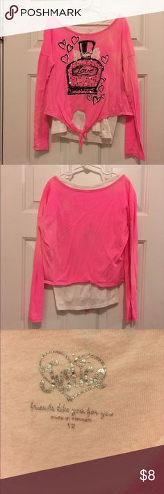 Size 12 Justice shirt Super cute size 12 pink and white Justice shirt with sequin details, one spot as shown in the picture, however I believe it will come out, good condition and gently used. Justice Shirts & Tops