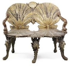 Venetian painted and parcel-gilt grotto furniture, circa 1900 - Each seat formed as a carved scallop shell above dolphin arm supports on rockwork carved legs. 41½ in.