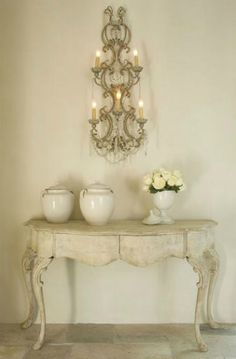 Love this table and the sconce