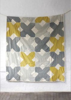 "pretty.    (Yardage: for 80X90"" quilt with 20"" Xs, 1.5 yds yellow, 2.5 yds dk grey, 2 yds lt grey, 3.25 yds white)"