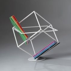 Magazines can be arranged at awkward angles within this sculptural magazine rack by Italian designer Marco Ripa.