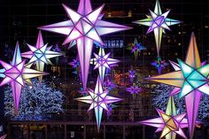 """Throughout the holiday season in New York City """"at the Great Room of Time Warner Center, a dozen 14-foot stars hanging from the ceiling make an enchanting choreographed light show set to holiday music. Each star twinkles to holiday tunes, capable of creating a myriad of color combinations."""" http://nyclovesnyc.blogspot.com/2009/11/holiday-under-stars-2009-visual-sound.html"""