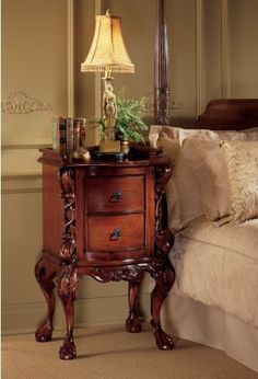 17th Century French Rococo Handcarved Mahogany Antique Replica Bedside Nights... by XoticBrands. $512.00. Hand-carved solid mahogany antique replica ; Each time you reach to shut off your bedside lamp, youll admire the deeply hand-carved mahogany in this 17th-century French antique replica. Inspired by the Rococo style, from its carved claw-and-ball feet to its ornate uprights, our exclusive boasts two deep drawers and quality metal pulls. This stunning work of furn...