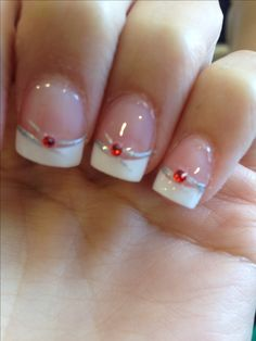 Wedding nails with a touch of dazzling red