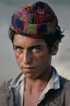 """stevemccurrystudios:  COLORS OF AFGHANISTAN""""A landscape might be denuded,a human settlement abandoned or lost,but always,just beneath the ground lies history of preposterous grandeur.. .They are everywhere, these individuals of undauntedhumankind, irrepressibly optimistic and proud."""" -The Carpet Wars,Christopher Kremmer"""