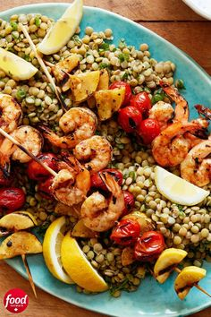 An herbed lentil salad is the perfect base for these grilled shrimp, tomato and squash skewers. While this recipe calls for dried lentils, you can always opt for canned to reduce the total cooking time. Lentil Recipes, Beef Recipes, Cooking Recipes, Dried Lentils, Skewers, Kebabs, Grilled Shrimp Recipes, Herb Salad, Food Network Canada