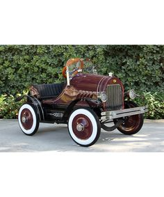 Burgundy Roadster Ride-On. I'd have loved this when I was little.