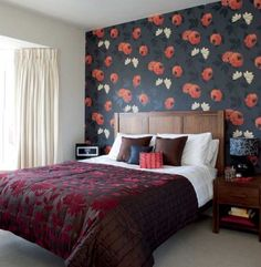 One wall wallpapered red.