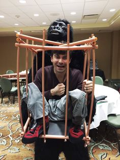 chris schmelke @chrisschmelke    How many people does it take to get Matt in a monkey cage suit? Apparently 9.