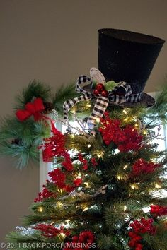 Love the simplicity...lights, berries, and that awesome snowman hat with a bow.