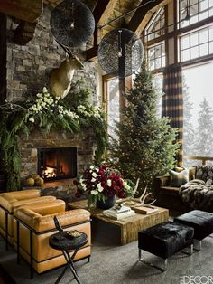 Hello Lovely...the loveliest rooms in America decorated for Christmas: a Montana living room in a ski house designed by Ken Fulk. #christmasdecor #christmasdecorating #holidaydecoratingideas #luxuryhome #kenfulk #greatroomdecorating #christmastreedecor #mountainlodge