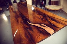 There are many beautiful and powerful elements which nature gives us to respect, to embrace and to use with care. This is our concept in Railis Design - we use gifts of nature with love and offer you handmade artworks. Dining Table SARMA Designed by Renats Kotlevs With modern copper legs and copper injection in wood this unique peace of artwork is almost invaluable! Epoxy resin - coating can be applied to almost any surface, giving it a high gloss and protective layer. The resin coating i...