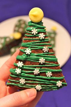 Christmas tree cookie with snowflakes. Design your simple chocolate cookies in Christmas tree designs and add edible snowflake candies on top.