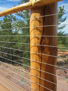 Ketchum, Idaho. Stainless Cable Infill Natural Peeled Wood Post and Top Rail