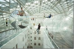 Hanging 80 feet in the air huge installation turned art lovers into 'spiders' by Tomas Saraceno