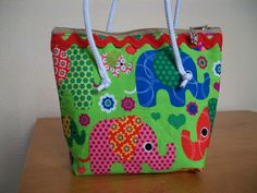 Elephants on parade!! Lined and zippered small bag.