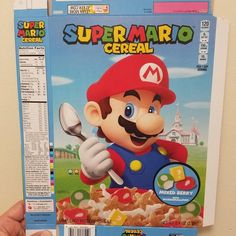A look at the Super Mario Cereal sample sleeve   As we all know this box doesn't match with the one we saw a few days back. We're not quite sure what's up with this one. It could be a prototype box or there could be alternate covers for the cereal. The amiibo version might be tougher to find and the box above would be the one stores would have more of.  from GoNintendo Video Games