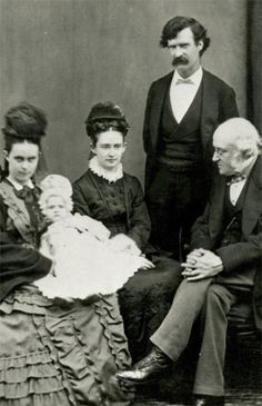 1873–1874 - Goes with family for five months to England, Scotland, and France. Goes to England by himself in November 1873. The Gilded Age, written with Charles Dudley Warner, is published. Pictured: Clara Spaulding, Susy Clemens, Olivia Clemens, Samuel Clemens, and Dr. John Brown, Edinburgh, Scotland.