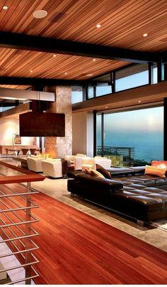 This is a stunning luxury home overlooking the ocean. The sleek modern furnishings and spectacular open fireplace, the wide open walls of glass. The wood floors and ceiling add it warmth. Gorgeous materials also design conception. Luxury Interior, Interior Architecture, Luxury Decor, Interior Stairs, Interior Ideas, Interior Decorating, Decorating Ideas, Amazing Architecture, Natural Interior