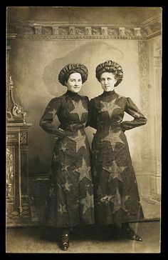 Real photo postcard. Two women in patriotic garb, identified as Audrey Moreland and Iva Case