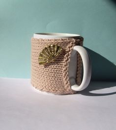Knitted Mug Cozy  Tan with Gold Fan Button by KatysKnitKnacks, $7.00
