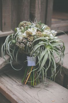 air plant bouquet, photo by Evynn LeValley http://ruffledblog.com/henry-miller-library-wedding #flowers #succulents #weddingbouquet