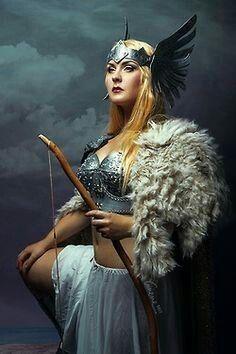 Winged headband + sexy armor + shearling epaulette = thumbs up