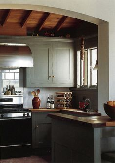 I love painted Shaker cabinets.  The British do them so well - especially with wooden countertops.