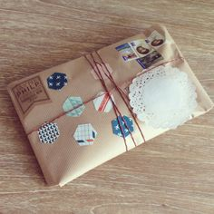 ♥♥ ✉ Simple parcel post decorated with what looks like the insides of security envelopes. Nice way to upcycle junk mail. ✉ Snail mail art at its best.