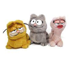"Vintage ""Garfield and Friends"" toys - Garfield, Arlene and Nermal stuffed animals. Garfield Cartoon, Garfield And Odie, Childhood Toys, Childhood Memories, Gi Joe, 1980s Toys, Cat Character, 80s Kids, Pink Cat"